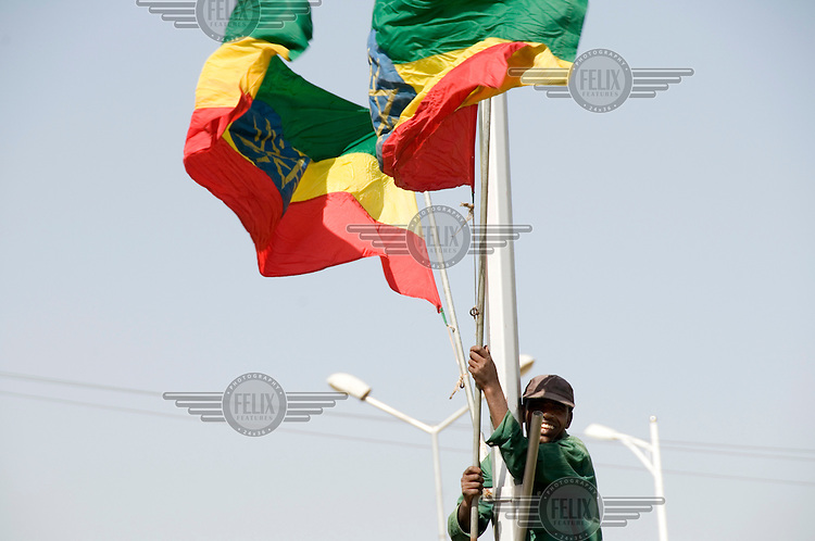 Hoisting Ethiopian flags.