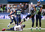 Seattle Seahawks cover specialists Richardo Lockette (83) celebrates after bringing down St. Louis Rams  kick returner Tavron Austin (11)during the quarter  at CenturyLink Field in Seattle, Washington on December 28, 2014.  The Seahawks officially wrapped up the No. 1 seed in the NFC playoffs shortly after beating the Rams, 20-6. Despite the Cowboys and Packers also winning to finish 12-4, the Seahawks (12-4) won the multi-team tiebreaker and earned home-field advantage throughout the playoffs for the second consecutive season.  ©2014. Jim Bryant Photo. All Rights Reserved.