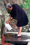A villager collects mineral water in a container on Terceira, Azores. Far out in the Atlantic Ocean, some 850 miles off the western coast of Lisbon, Portugal lies the 425-mile long archipelago of the Azores. (Jim Bryant Photo).....
