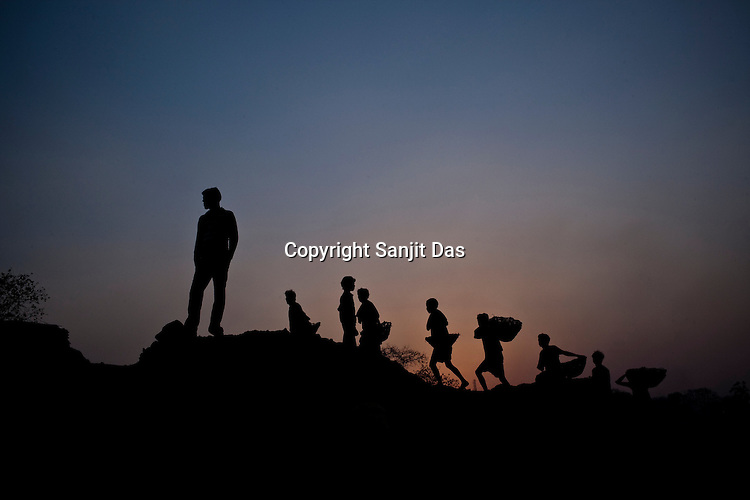 Miners return to Bokapahari from work after a day long work from the coal mines of Jharia in Jharkhand, India. Photo: Sanjit Das