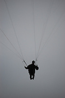 A paraglider soars above Torrey Pines Glider Port in San Diego California, October 21 2007.