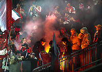 16 April 2011: The Toronto FC fans ignited a flare while security tries to extinguish it during an MLS game between D.C. United and the Toronto FC at BMO Field in Toronto, Ontario Canada..D.C. United won 3-0.