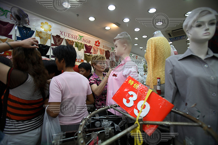 Women shop for clothes sale in Shanghai.