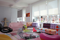 Karim Rashid's New York apartment is filled with colourful furniture and a collection of contemporary glass