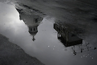 A church is reflected in a puddle of water in Manila, Philippines..**For more information contact Kevin German at kevin@kevingerman.com