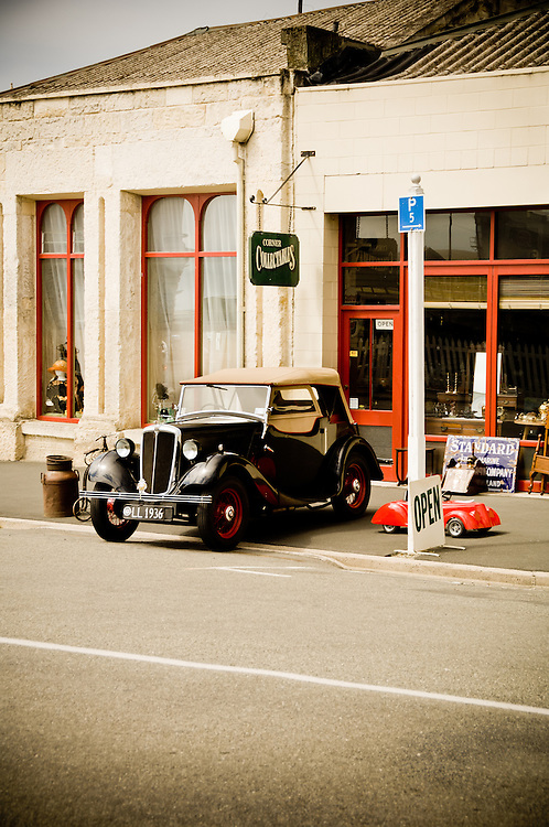 Vintage car, outside a antique store in the historic district, Oamaru, South Island, New Zealand - stock photo, canvas, fine art print