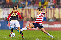 Carli Lloyd (10) of the United States (USA) stretches for a ball. The United States (USA) and Germany (GER) played to a 2-2 tie during an international friendly at Rentschler Field in East Hartford, CT, on October 23, 2012.