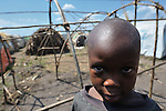 A boy in a camp in rebel-held territory in the eastern Congo. Families displaced by fighting between rebel Tutsi General Laurent Nkunda and the Congolese military took refuge in this camp they established in the shadow of a United Nations base in the village of Kiwanja. According to aid workers and human rights groups, rebel soldiers executed some 150 people here in a 24-hour period in early November. The killings took place half a mile from the UN base, yet the 120 UN peacekeepers, part of the largest UN peacekeeping contingent in the world, did not take any action to stop the violence. ...
