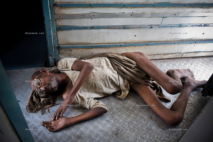 An unconscious elderly man lies by the door on the Himsagar Express 6318 on 7th July 2009.. .6318 / Himsagar Express, India's longest single train journey, spanning 3720 kms, going from the mountains (Hima) to the seas (Sagar), from Jammu and Kashmir state of the Indian Himalayas to Kanyakumari, which is the southern most tip of India...Photo by Suzanne Lee / for The National