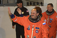 Space Shuttle Discovery crew member Yury Usachev, of Rissia, waves to the media at the beginning of the STS 102 Mission, Kennedy Space Center, Titiusville, FL,  March 2001.  (Photo by Brian Cleary/www.bcpix.com)