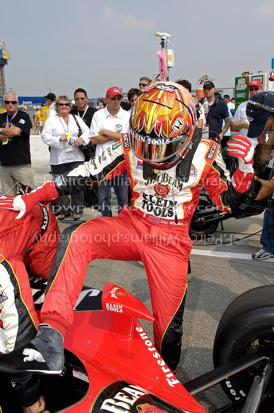 11 September, 2005, Joliet,IL,USA<br /> Dan Wheldon climbs into his car.<br /> Copyright&copy;F.Peirce Williams 2005