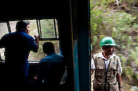 Train employees enjoy the view while aboard the tren macho.