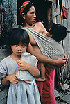 PHILIPPINES-10027, A mother of the Bontoc minority stands with her school bound daughter outside there home in Luzon, Philippines, 1986<br />