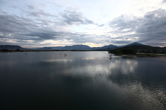 The sun sets over the Cu De River near Da Nang, Vietnam. Aug. 12, 2012.