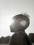 A boy outdoors in the sun.