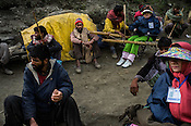 Hindu pilgrims and their Kashmiri porters stop to rest along the Amarnath trekking route in Panchtarni in Kashmir, India. Hindu pilgrims brave sub zero temperature and high latitude passes and make their pilgrimage to reach the sacred Amarnath cave, which houses a lingam - a stylized phallus, worshiped by Hindus as a symbol of God Shiva. Photo: Sanjit Das/Panos