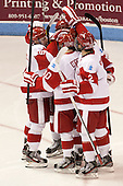 Matt Grzelcyk (BU - 5), Danny O'Regan (BU - 10), Ryan Ruikka (BU - 2) - The Boston University Terriers defeated the visiting Northeastern University Huskies 5-0 on senior night Saturday, March 9, 2013, at Agganis Arena in Boston, Massachusetts.