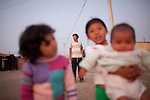 Children pose for a picture on Thursday, Apr. 16, 2009 in Ventanilla, Peru.