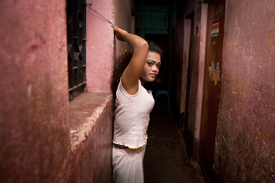 "Faridpur Brothel is the second to largest brothel in Bangladesh. (17 registered brothels in the country) 600+ girls live in a hidden neighboorhood accesible through one of the six alleyways, covered with small ragged curtains mimicking doors. Many girls are under aged - the ""legal"" age being 18. The chhukris wait during long periods of time for clients to walk past their rooms, the girls are forced to stake out their territory 24h/7 365 days a year. March 10, 2011. Gabriela Barnuevo"