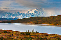 Morning light and clouds over Mt McKinley (Denali) North America's tallest mountain (20,320 ft), and Wonder Lake, Denali National Park, interior, Alaska.