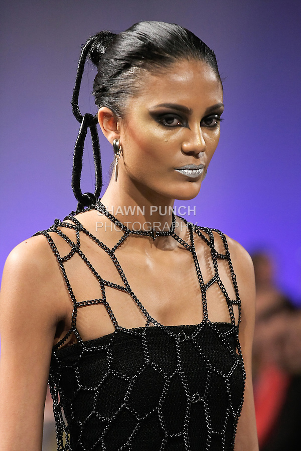 Model walks the runway in an outfit from the LaureLuxe Metal Couture and Jewelry Fall 2012 collection, by Laurel Mae DeWitt, during Couture Fashion Week in New York, February 18, 2012.