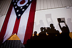 Shadows on a wall with an Ohio flag while Republican vice presidential candidate Rep. Paul Ryan speaks at a campaign rally at Baldwin Wallace University in Berea, Ohio, October 17, 2012.