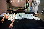 Nassir Ahmad, 8, lies in the emergency ward at Mirwais Hospital in Kandahar, Afghanistan, Saturday morning, Apr. 18, 2009. Two people were killed and five more were injured when a bomb detonated just outside the hospital, as a police vehicle went by. Afghan police said the explosion was set off by a suicide bomber. Ahmad was on an errand to buy tablets for his mullah at a nearby pharmacy when he was hit by shrapnel from the bomb blast. Despite worsening security, development continues at Mirwais Hosptial, where the International Committe of the Red Cross conducts training and assists the local staff. Mirwais is the main public hosptial serving five southern provinces. As security has deteriorated in the South, many international NGO's have pulled their staff from the area or shut down the regional office, stunting development in a region where it is badly needed.