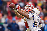 KANSAS CITY, MO - DECEMBER 14:   Stephen Cooper #54 of the San Diego Chargers breaks up a pass thrown to Tony Gonzalez #88 of the Kansas City Chiefs on December 14, 2008 in Kansas City, Missouri.  The Chargers defeated the Chiefs 22-21.  (Photo by Wesley Hitt/Getty Images) *** Local Caption *** Stephen Cooper