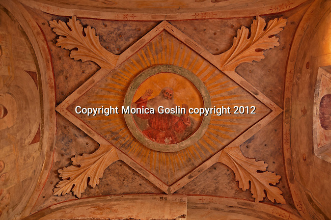Fresco on the roof of the side chapel in the Church of San Salvatore which is a culimination of different centuries from the Roman ruins to 6th century columns to 15th and 16th century frescos; The Church of San Salvatore in the Santa Giulia Museum Complex in Brescia, Italy