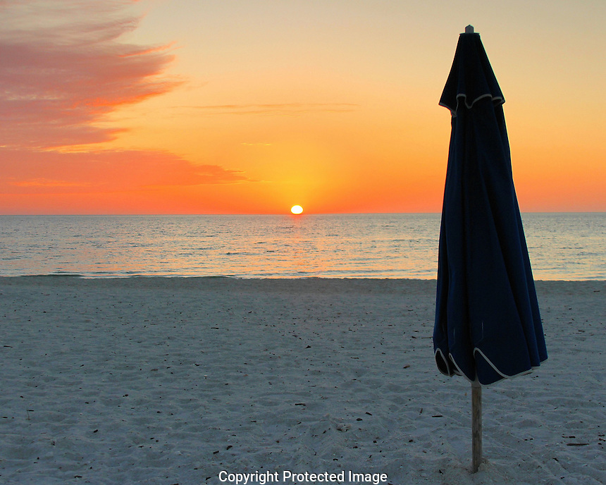 Thanks to the Hilton attendant for leaving the umbrella up while I took a few images of a gorgeous January sunset. Hope you enjoy the pic but in all honesty it was so much better being there on the beach.