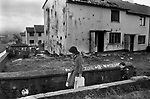 Northern Ireland Derry Londonderry  the catholic Creggan Estate. Burn out house in Rinmore Drive  1983.