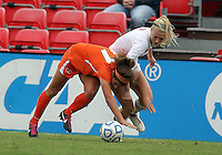 COLLEGE PARK, MD - OCTOBER 28, 2012:  Ashley Spivey (8) of the University of Maryland knocks over Kim Hutchinson (17)  of Miami during an ACC  women's tournament 1st. round match at Ludwig Field in College Park, MD. on October 28. Maryland won 2-1 on a golden goal in extra time.