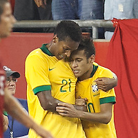 Brazil forward Neymar (10) celebrates his goal with Brazil forward Jo (21). In an international friendly, Brazil (yellow/blue) defeated Portugal (red), 3-1, at Gillette Stadium on September 10, 2013.