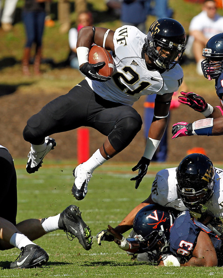 Wake Forest safety Desmond Cooper (21) leaps through the defensive line during the game against the Virginia at Scott Stadium in Charlottesville, Va. Wake Forest defeated Virginia 16-10. Photo/The Daily Progress/Andrew Shurtleff