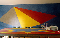 The mural and table top in the dining room are the creation of artist Sol LeWitt