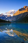 Dawn light on Mount Edith Cavell reflected in Cavell Lake, Jasper National Park, Alberta, Canada