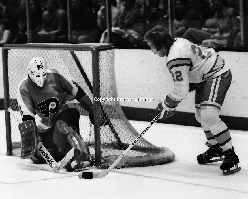 California Golden Seals Joey Johnston against Philadelphia Flyer goalie Bernie Parent. (1975 photo by Ron Riesterer)