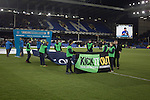 Everton 0 West Bromwich Albion 0, 19/01/2015. Goodison Park, Premier League. Young people with anti-racism 'Kick It Out' banners on the pitch at Goodison Park, Liverpool before the Premier League match between Everton and West Bromwich Albion. The match ended in a 0-0 draw, despite the home team missing a first-half penalty by Kevin Mirallas. The game was watched by 34,739 spectators and left both teams languishing near the relegation zone. Photo by Colin McPherson.