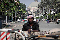 In this Sunday, Jul. 07, 2013 photo, a Muslim Brotherhood member stands as he mounts guard in a barricade at the Cairo University in Cairo, Egypt. (Photo/Narciso Contreras).