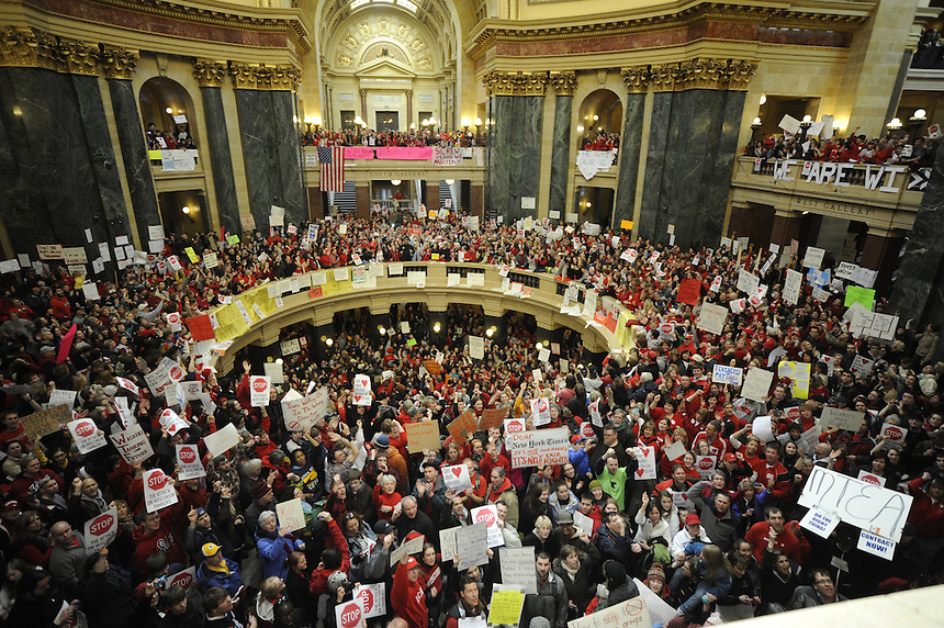 Some of the thousands of protesters rally inside the Wisconsin state capitol dome on Friday, Feb. 18, 2011 to protest a proposed bill by Gov. Scott Walker and the Republican-controlled state senate. Near the center of the photo at the railing is the Rev. Jesse Jackson, a surprise visitor to the event. It marked the fourth straight day of large protests against the bill, which would strip state employees of many of their collective bargaining rights. Ernie Mastroianni photo.