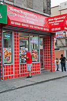 A New Kennedy Fried Chicken franchise restaurant is seen on Lenox Avenue in Harlem in New York on Saturday, July 28, 2012.  (© Richard B. Levine)