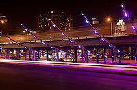 Traffic races by the bright neon purple and pink lights the IH-35 Makeover Project is a site to see and park in