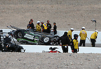 Nov 1, 2014; Las Vegas, NV, USA; NHRA safety safari crews tend to pro stock driver Deric Kramer after he crashes during qualifying for the Toyota Nationals at The Strip at Las Vegas Motor Speedway. Kramer was unhurt in the accident. Mandatory Credit: Mark J. Rebilas-USA TODAY Sports