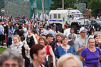 Moscow, Russia, 19/05/2012..Riot police watch as several thousand artists and opposition activists demonstrate against Vladimir Putin by walking through Moscow transporting their artworks. The protest coincided with Museum Night, when Moscow's museums are open until midnight with special exhibitions and performances.