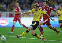 Fussball Bundesliga Saison 2011/2012 1. Spieltag Borussia Dortmund - Hamburger SV V.l.: Kevin GROSSKREUTZ (BVB) erzielt das Tor zum 1:0 gegen Dennis DIEKMEIER (HSV).
