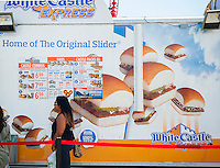Customers line up at a White Castle hamburger seasonal mobile restaurant in Coney Island in Brooklyn in New York on Sunday, August 24, 2014. (© Richard B. Levine)