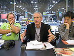 Mickey Osterreicher, attorney for the NPPA, addresses meeting at Photo Plus Expo as Roy Hsu of the Stock Artists Alliance, right, and Martin Trailer of APA look on.