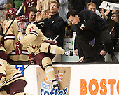 Pat Mullane (BC - 11), Tom Maguire (BC - Senior Manager) - The Boston College Eagles defeated the Northeastern University Huskies 6-3 on Monday, February 11, 2013, at TD Garden in Boston, Massachusetts.