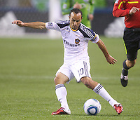 L.A. Galaxy forward Landon Donovan passes the ball during play against the Seattle Sounders FC at Qwest Field in Seattle Tuesday March 15, 2011. The Galaxy won the game 1-0.