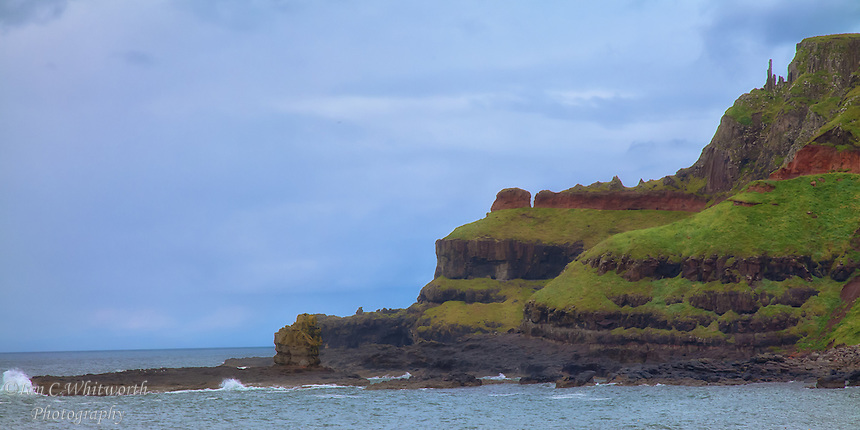 "Looking at the ""chimney tops"" at the Giants Causeway on the Antrim Coast in North Ireland."